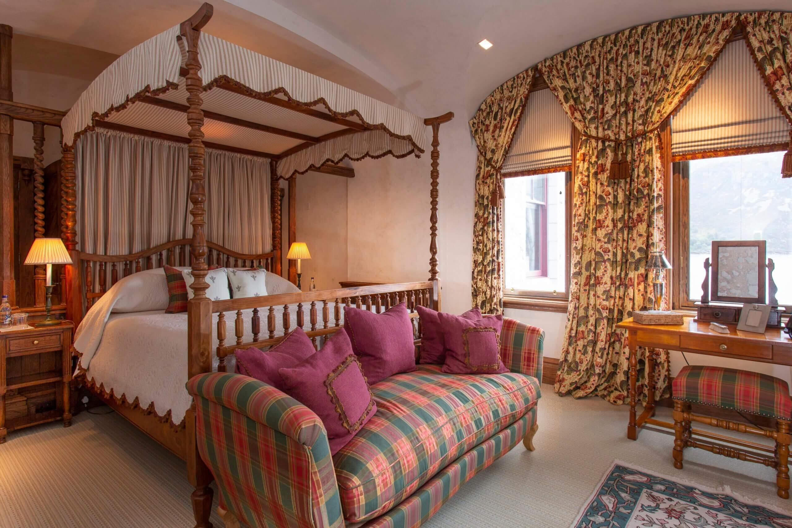 Bedroom with king size four poster bed and incredible views