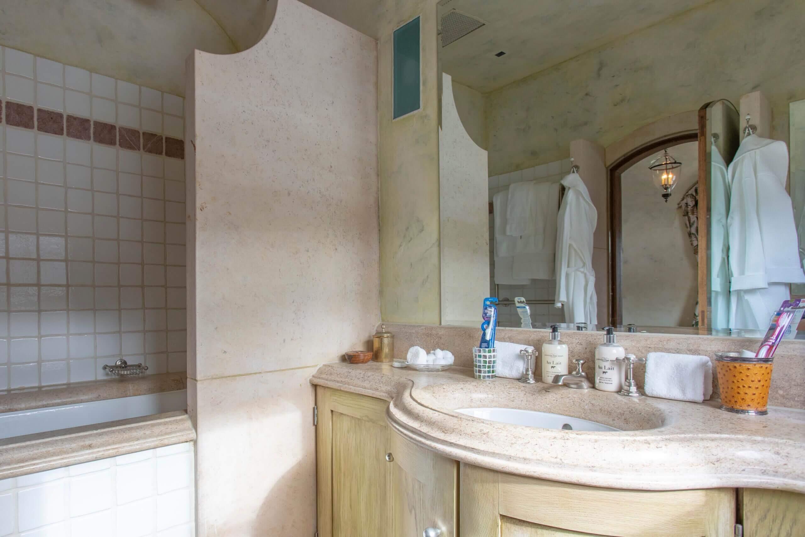 En suite bathrooms with marble vanity tops